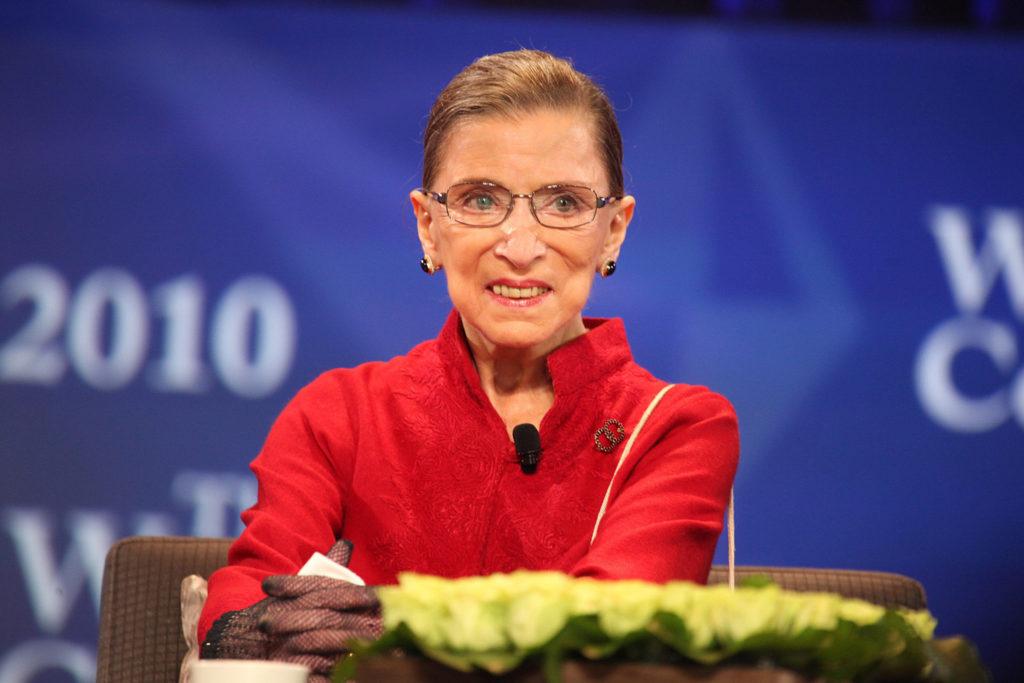 Ruth Bader Ginsburg seated at a table